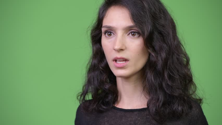 Young beautiful woman looking shocked | Shutterstock HD Video #1013990498