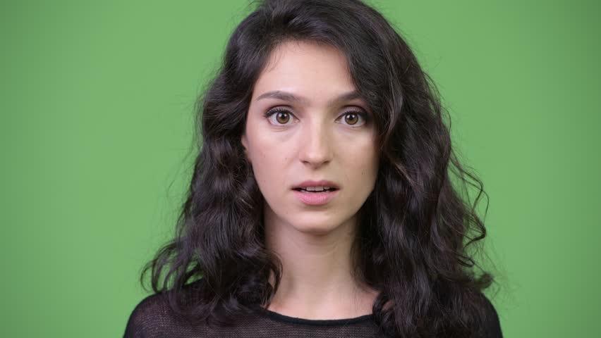 Young beautiful woman looking shocked | Shutterstock HD Video #1013990501