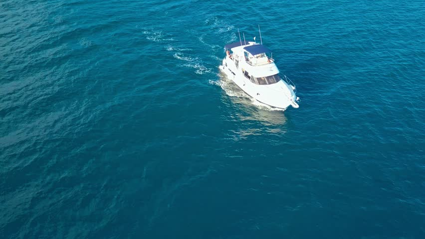 top view of fast travel boat going straight forward in the sea aerial shot #1014002684