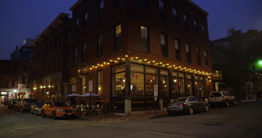 PORTLAND, MAINE - Circa July, 2018 - A nighttime establishing shot of a corner bar and restaurant in the tourist district of a city.  Additional rights may be needed for commercial use.