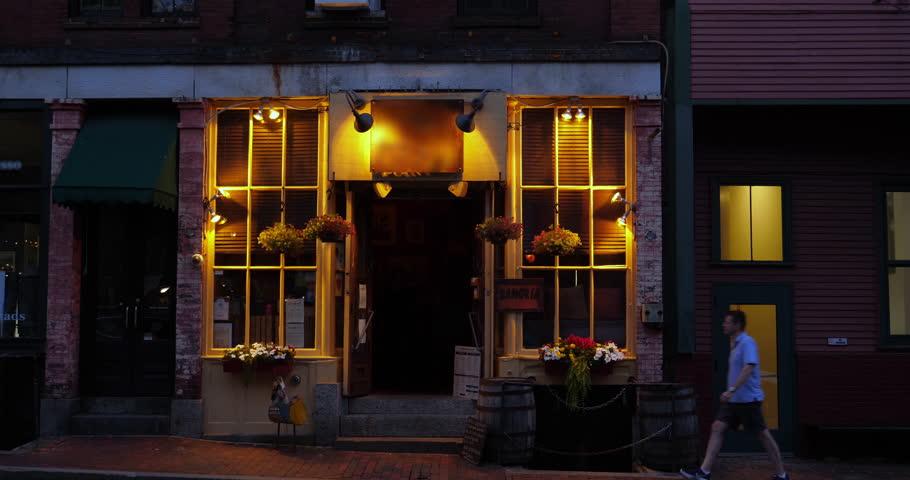 An evening establishing shot of a New England city's bar or restaurant.