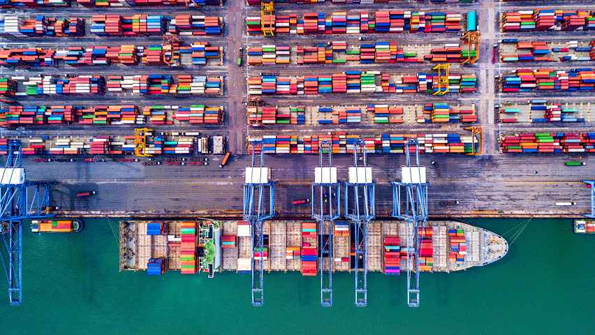 4K Timelapse of modern industrial port with containers from top view or aerial view. It is an import and export cargo port where is a part of shipping dock.Singapore
