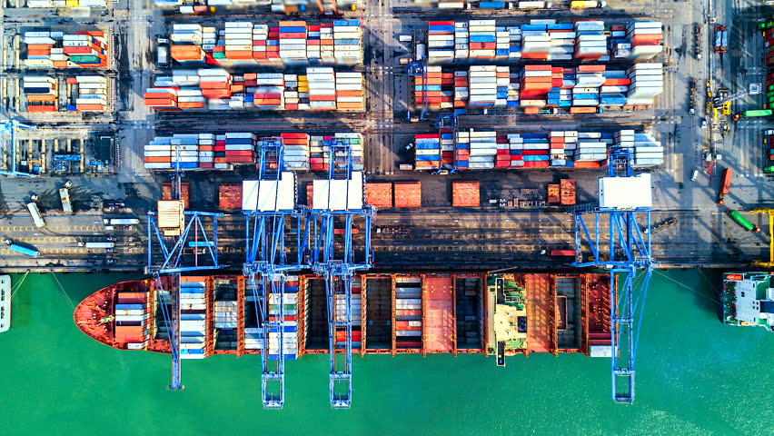 4K Timelapse of modern industrial port with containers from top view or aerial view. It is an import and export cargo port where is a part of shipping dock. Singapore