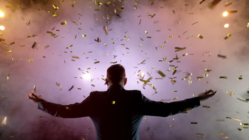 Successful businessman with arms up celebrating his victory. Celebrating success. Low angle view of excited young businessman keeping arms raised and expressing positivity while stands on the stage in | Shutterstock HD Video #1014025049