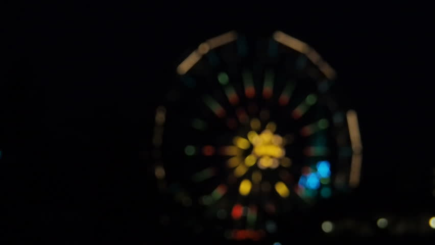 Glowing carousels at night. Carousel lights. There is no focus. Blur.   Shutterstock HD Video #1014027509