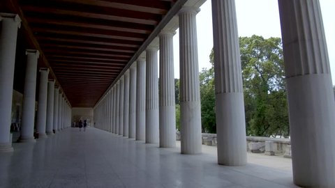 Tracking shot camera moves slowly forward in the interior length of Stoa of Attalos in Athens