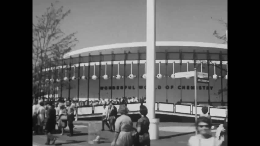 """CIRCA 1960s - Exterior shots of many pavilions are seen at the 1964 New York World's Fair, including what will become the """"It's A Small World"""" ride."""