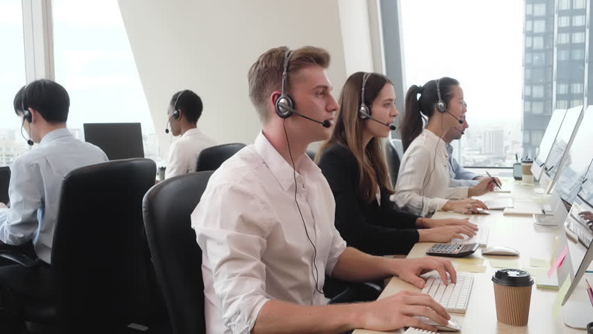 Group of diverse people wearing microphone headset working in call center office as customer service telemarketing agents