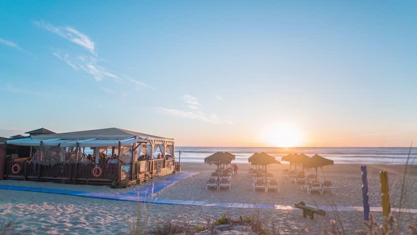 Day to night Timelapse of beautiful beach with Chiringuito (spanish beach restaurant)