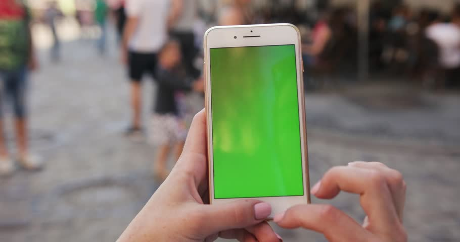 PARIS, FRANCE- APRIL 05, 2017: close up woman hand holding mobile smart phone with vertical green screen and touch to zoom display new technology outdoor message device adult digital girl finger green | Shutterstock HD Video #1014104351
