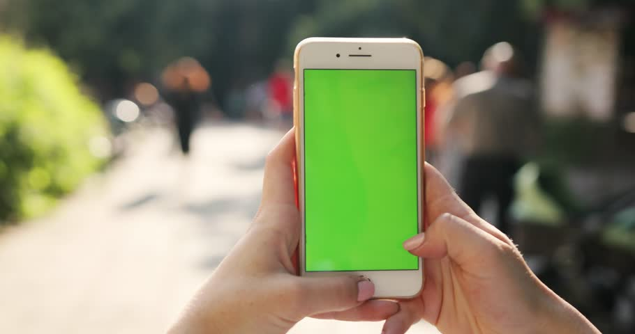 PARIS, FRANCE- APRIL 05, 2017: Slow motion close up woman hand holding mobile smart phone with chroma green screen and touch to zoom  | Shutterstock HD Video #1014104369