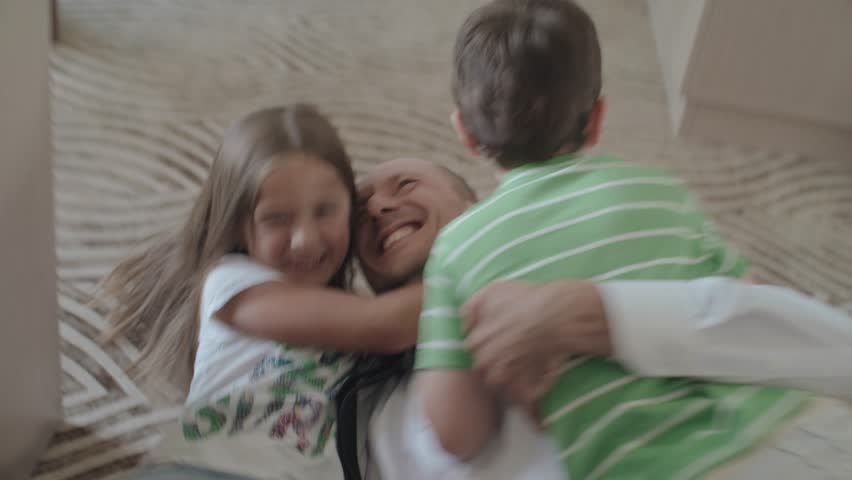 Happy Children Meet The Father Who Came From Work. Children Run To Their Father And Hug Him. | Shutterstock HD Video #1014109670