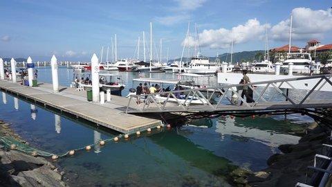 Kota Kinabalu,Sabah, Malaysia-January 14, 2018 : Unidentified tourist are ready to up speed boat to go most famous island in Kota Kinabalu, MAMUTIK ISLAND is the most famous tourist spot island.