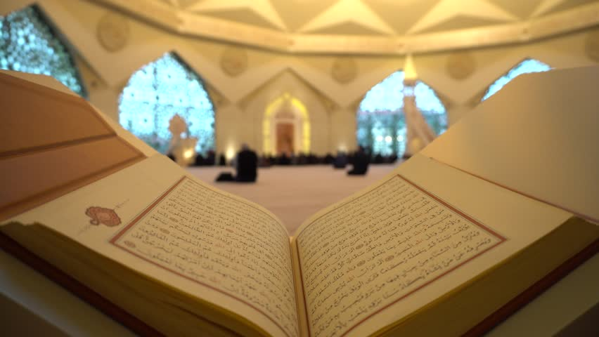A Man Is Reading Quran Or Koran On The Reading Desk In A Mosque.   Shutterstock HD Video #1014138113