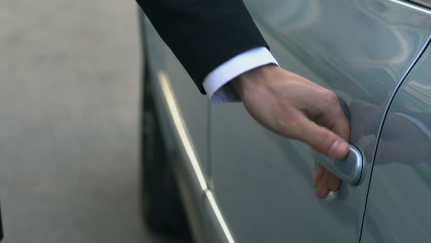 Personal driver opening car door to his boss, male getting out of automobile Royalty-Free Stock Footage #1014144953