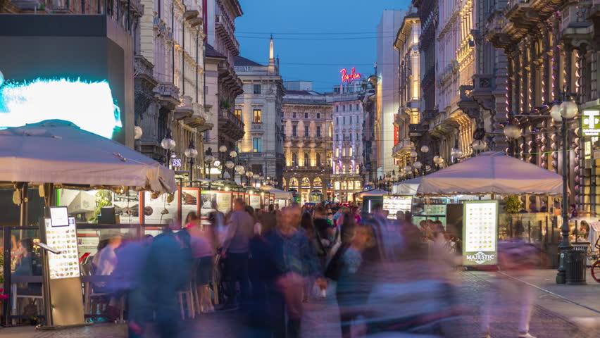 MILAN, ITALY - MAY 18 2018: city night illuminated famous crowded dante street panorama 4k timelapse circa may 18 2018 milan, italy.