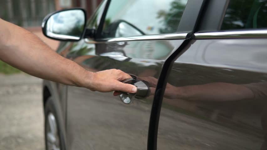 The man opening car door   Shutterstock HD Video #1014184028