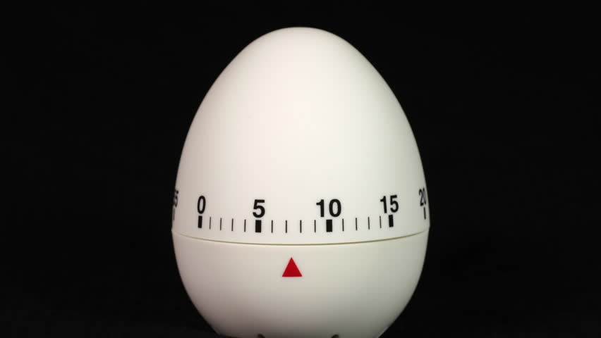 White kitchen egg timer countdown to zero time lapse on a black background. | Shutterstock HD Video #1014192779