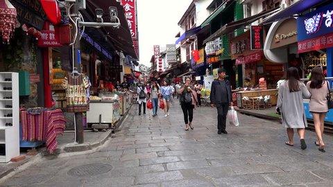 YANGSHUO, - OCTOBER 12: Tourists at Xi Jie pedestrian street of Yangshuo Town. October 12, 2017 in Yangshuo, Guilin, Guangxi Zhuang, China