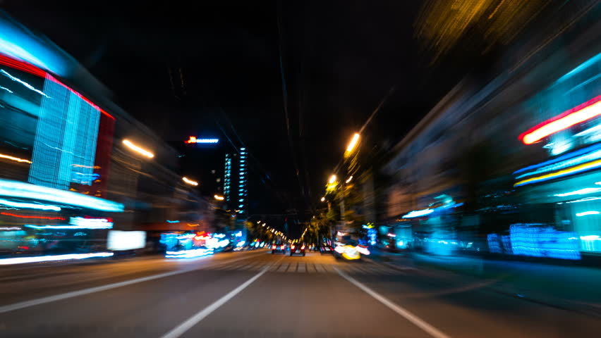 Night driving of a car in a metropolis through the streets and roads of the city | Shutterstock HD Video #1014205313