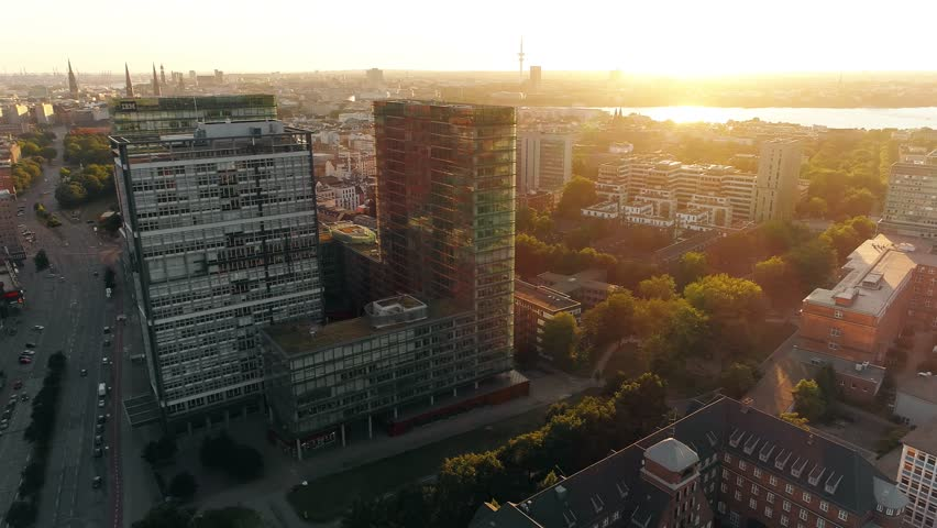 Aerial view of Hamburg (Germany). Cityscape and big modern buildings at sunset. A sunset Aerial shot of skyscrapers of Hamburg Business Centre. #1014207365