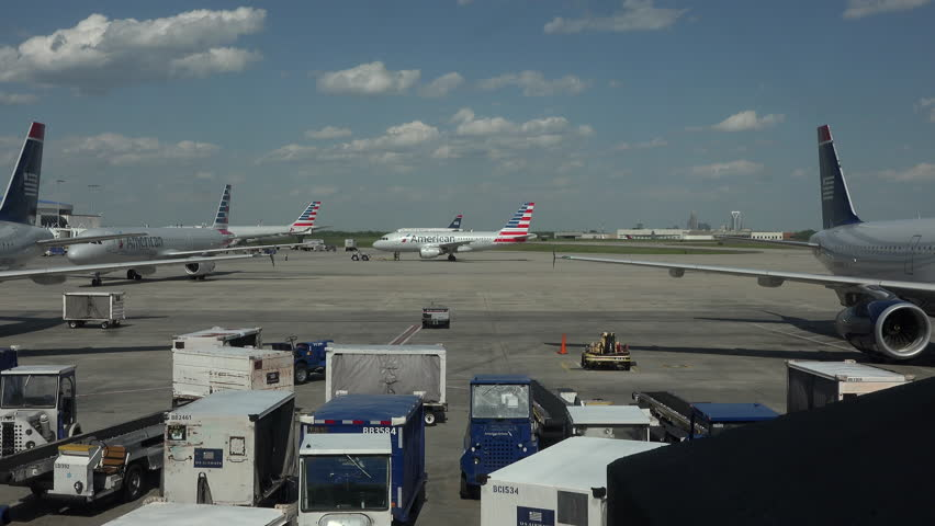 WASHINGTON, DC - APR 2015: American Airlines aircraft taxi Dulles International Airport 4K. Busiest airport in the Washington metropolitan area. Served over 21.6 million passengers in 2014. Busy ramp.