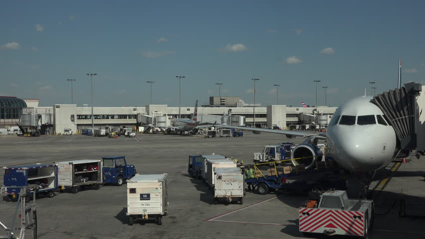 WASHINGTON, DC - APR 2015: Aircraft empty cargo Dulles International Airport ramp fast 4K. Busiest airport in the Washington metropolitan area. Served over 21.6 million passengers in 2014. Busy ramp.
