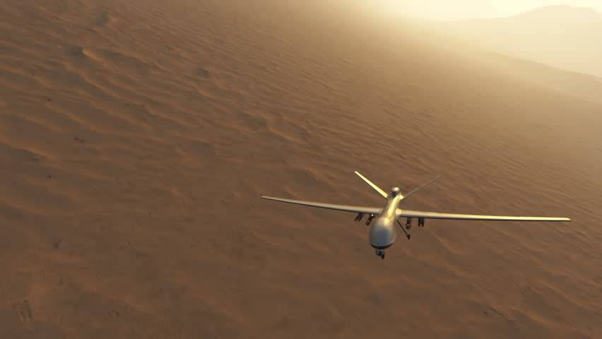 03593 Military predator drone flying over desert and mountains. Camera is fixed to drone.