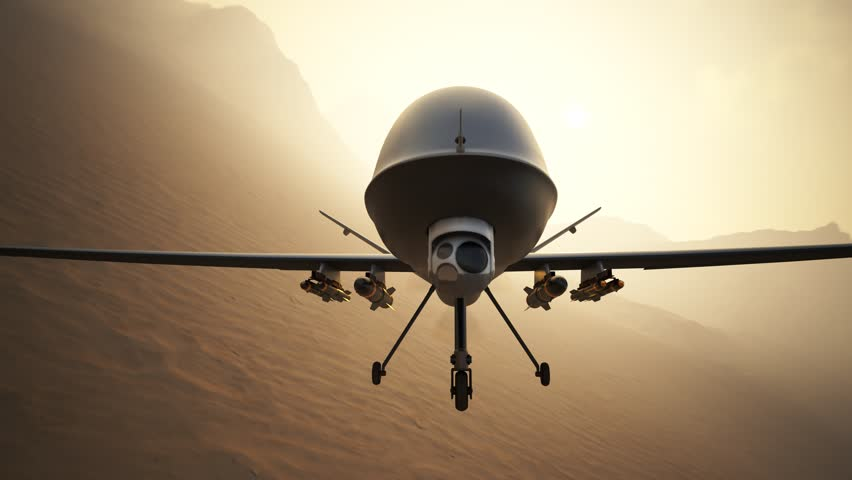 03594 Military predator drone flying over desert and mountains. Camera is fixed to drone.
