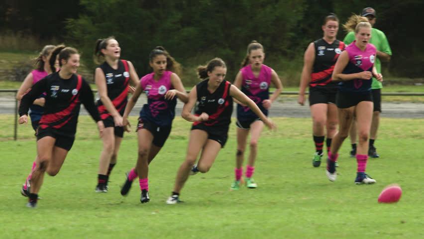 Slow-motion shot of WAFL U16 girls playing match at Timboon, Victoria, Australia - March 16 2018.
