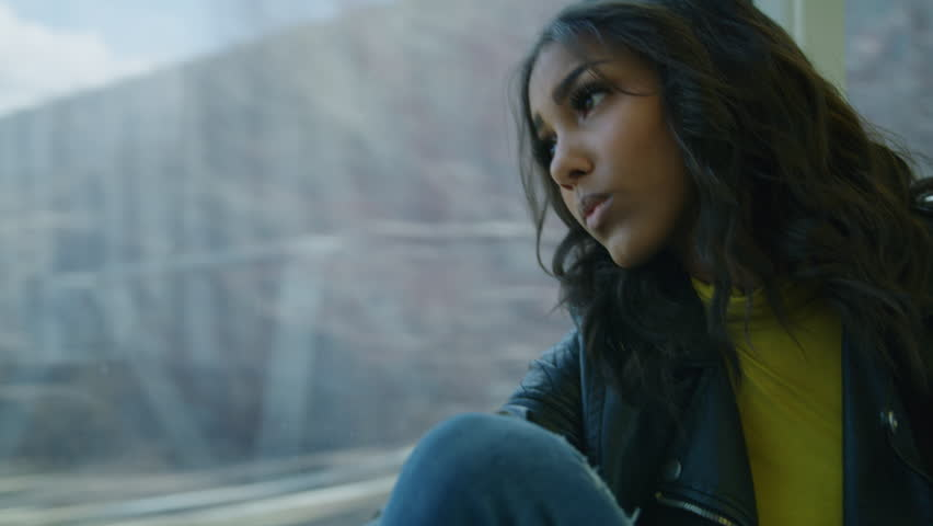 Close up of daydreaming woman riding train and leaning head on window / Salt Lake City, Utah, United States | Shutterstock HD Video #1014239645