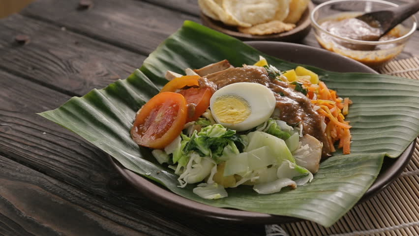gado-gado delicious vegetable and rice cake with peanut sauce. traditional food Royalty-Free Stock Footage #1014255293