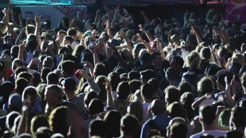 BRISTOL - JULY 21 2018: Crowd of People Waving Arms in the Air at Music Festival Concert, Bristol Harbour Festival on July 21 2018 in Bristol, England #1014266954