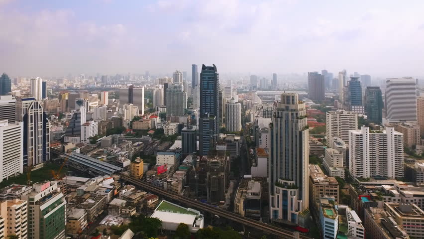 Aerial view of Bangkok downtown. Real estate development Asia. Flying over Bangkok, Thailand.
