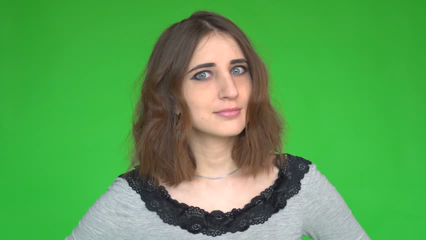 Portrait of a young woman posing against a removable chroma key background. | Shutterstock HD Video #1014302246