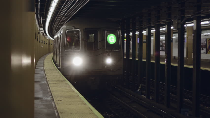 New York City subway train arriving to the underground statio