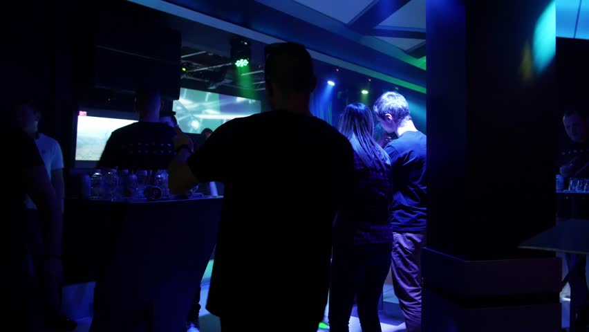 Sofia, Bulgaria, July 2018 - Crowd dancing in a night club with electronic dance music techno dj #1014335648