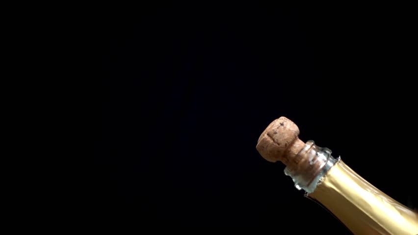 a champagne cork is popping out in slow motion #1014344207