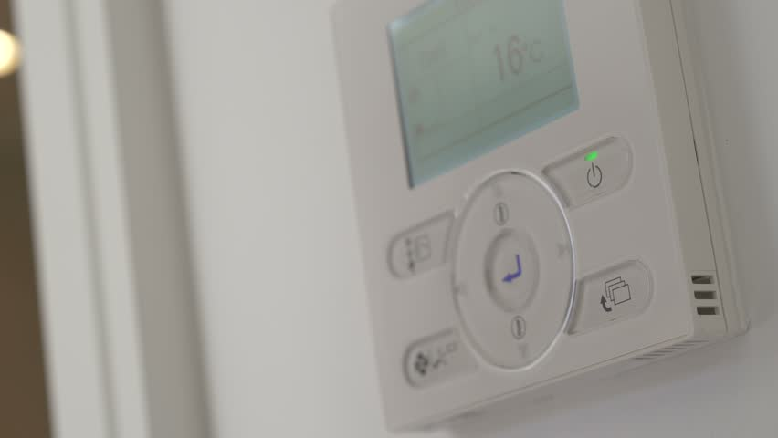 Finger presses the button on air conditioner Royalty-Free Stock Footage #1014354461