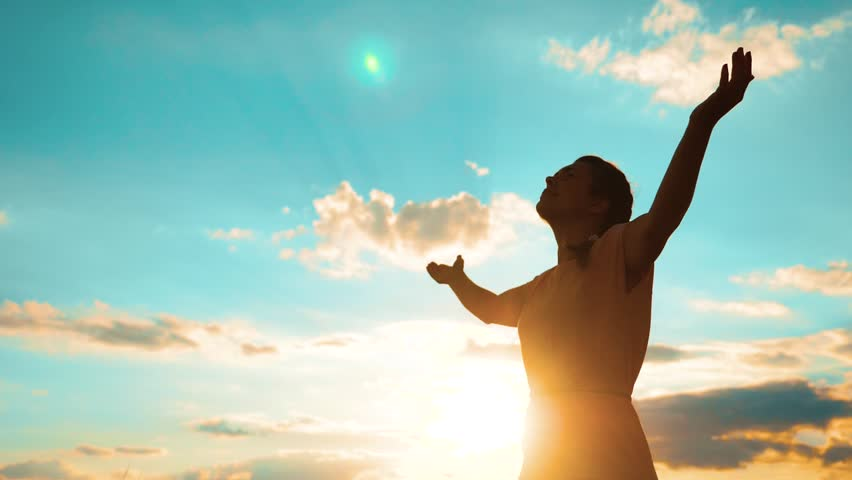 Woman praying on her knees. Girl folded her hands in prayer silhouette at lifestyle sunset. slow motion video. Girl folded her hands in prayer pray to God. the girl praying asks forgiveness for sins | Shutterstock HD Video #1014361610