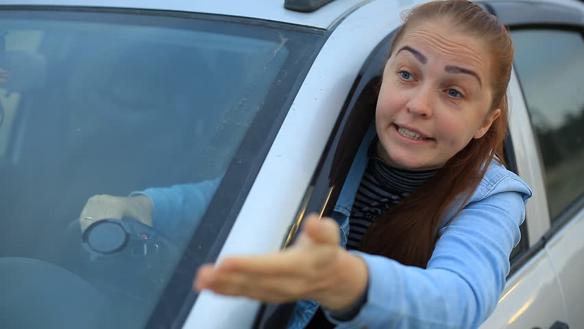 Middle aged woman sits in the car and complains on traffic situation - car stands on the verge of road in countryside   Shutterstock HD Video #1014362537