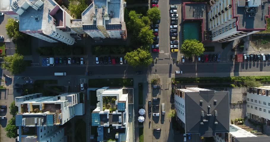 Rooftops, Parking Spot, Residential Apartment. Top Down Drone Shot #1014411311