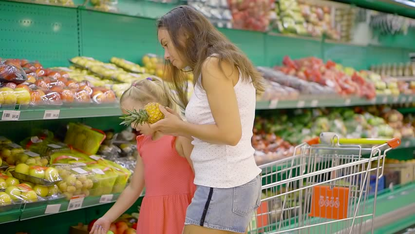 Mother and daughter shopping in grocery store. | Shutterstock HD Video #1014435074
