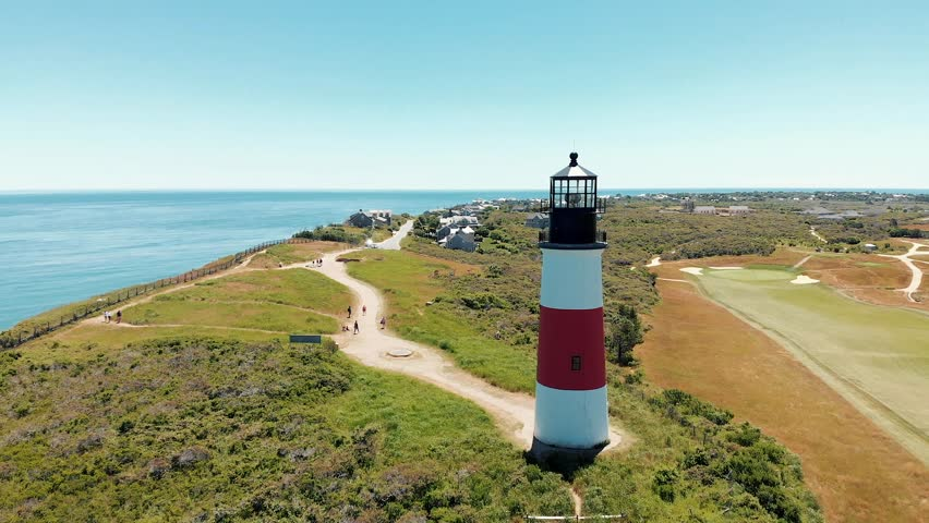 Aerial drone shot of a coastal lighthouse on Nantucket island in Massachusetts.