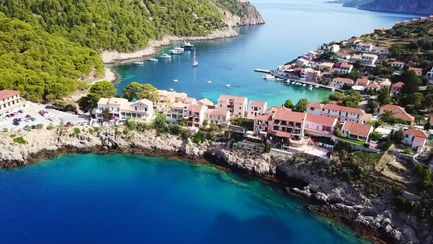 Aerial drone bird's eye view video of beautiful and picturesque colorful traditional fishing village of Assos in island of Cefalonia, Ionian, Greece