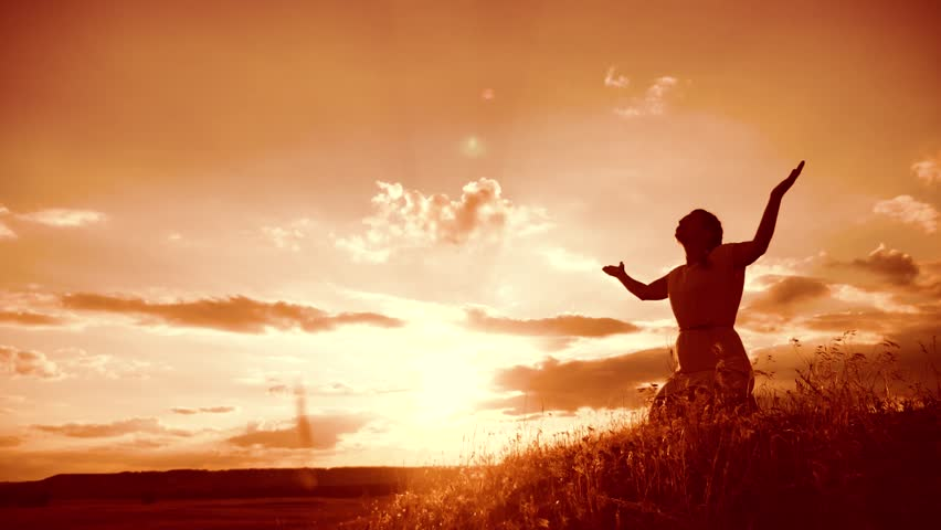 Girl folded her hands in prayer silhouette at sunset. woman praying on her knees lifestyle. slow motion video. Girl folded her hands in prayer pray to God. the girl praying asks forgiveness for sins | Shutterstock HD Video #1014484472