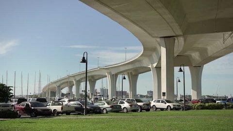 Clearwater, United States - June, 2017: Cars parked under Causeway Bridge
