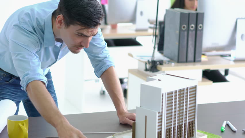 Architects are working on a building model at modern office. Designer are developing architecture. concept of construction, development and creative idea. Royalty-Free Stock Footage #1014496814
