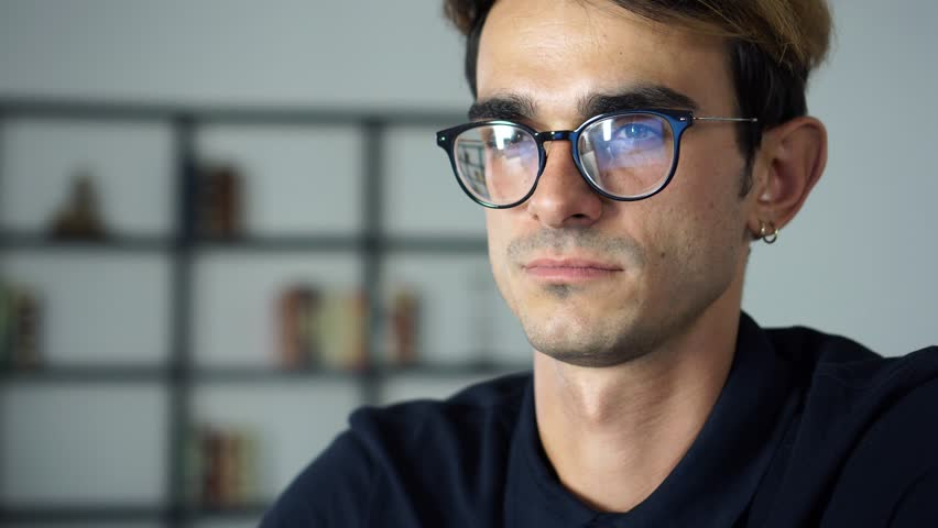 Portrait of succcessful young man working and looking in the Monitor, Computer Screen Reflects in His Glasses #1014534734