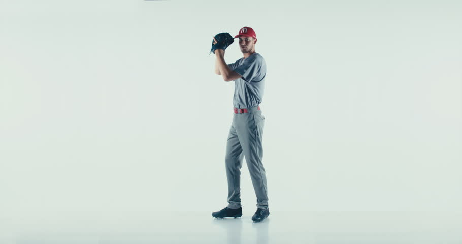 Caucasian professional baseball player pitcher throwing a ball towards camera isolated on white background. 4K UHD 60 FPS SLOW MOTION